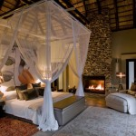 Luxury safari lodges like Chitwa Chitwa drape beds with net, for protection against mosquitos