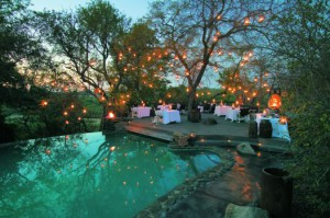 Dinner setting in the wilderness at a premier Singita Lodge in the Sabi Sand